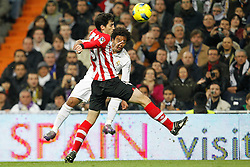 22.01.2012, Santiago Bernabeu Stadion, Madrid, ESP, Primera Division, Real Madrid vs Athletic Bilbao, 1. Spieltag, Nachtrag, im Bild Real Madrid's Marcelo and Athletic de Bilbao's Fernando Amorebieta // during the football match of spanish 'primera divison' league, 1th round, supplement, between Real Madrid and Athletic Bilbao at Santiago Bernabeu stadium, Madrid, Spain on 2012/01/22. EXPA Pictures © 2012, PhotoCredit: EXPA/ Alterphotos/ Cesar Cebolla..***** ATTENTION - OUT OF ESP and SUI *****