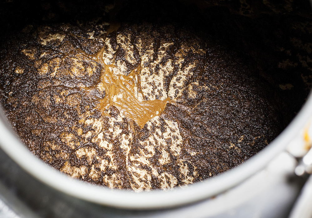Grounds are filtered out of Big Watt cold press coffee in a tank at Burning Brothers Brewing in St. Paul December 15, 2015.