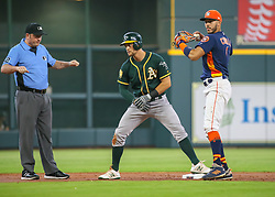 April 29, 2018 - Houston, TX, U.S. - HOUSTON, TX - APRIL 29:  Oakland Athletics center fielder Chad Pinder (18) is safe at second base during the baseball game between the Oakland Athletics and Houston Astros on April 29, 2018 at Minute Maid Park in Houston, Texas.  (Photo by Leslie Plaza Johnson/Icon Sportswire) (Credit Image: © Leslie Plaza Johnson/Icon SMI via ZUMA Press)