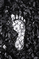 White footprint on coal view from above