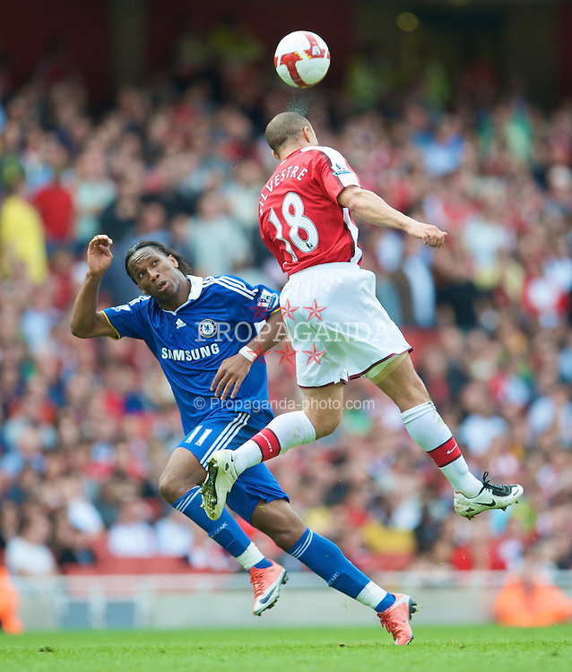 LONDON, ENGLAND - Sunday, May 10, 2009: Arsenal's Mikael Silvestre and Chelsea's Didier Drogba during the Premiership match at the Emirates Stadium. (Photo by David Rawcliffe/Propaganda)