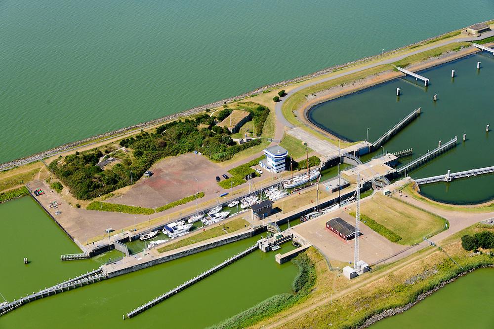 Nederland, Friesland, Kornwerderzand, 05-08-2014; Afsluitdijk met sluizencomplex. IJsselmeer.<br /> Enclosure Dam near the Frisian coast. Sluices and locks. <br /> <br /> luchtfoto (toeslag op standaard tarieven);<br /> aerial photo (additional fee required);<br /> copyright foto/photo Siebe Swart.