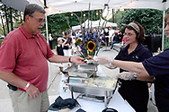 """A man who """"grew up in Belmont"""" gets ready to sample the last cabbage roll from Belmont Catering during the 21st annual The Taste in the Lincoln Park Commons area at the Fraze Pavilion, Thursday, September 3, 2009."""