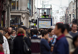 © Licensed to London News Pictures. 26/12/2012. London, UK. As thousands across the UK take advantage of Boxing Day sales a member of the Metropolitan Police Service keeps watch over shoppers on Oxford Street in London today (26/12/12). Photo credit: Matt Cetti-Roberts/LNP