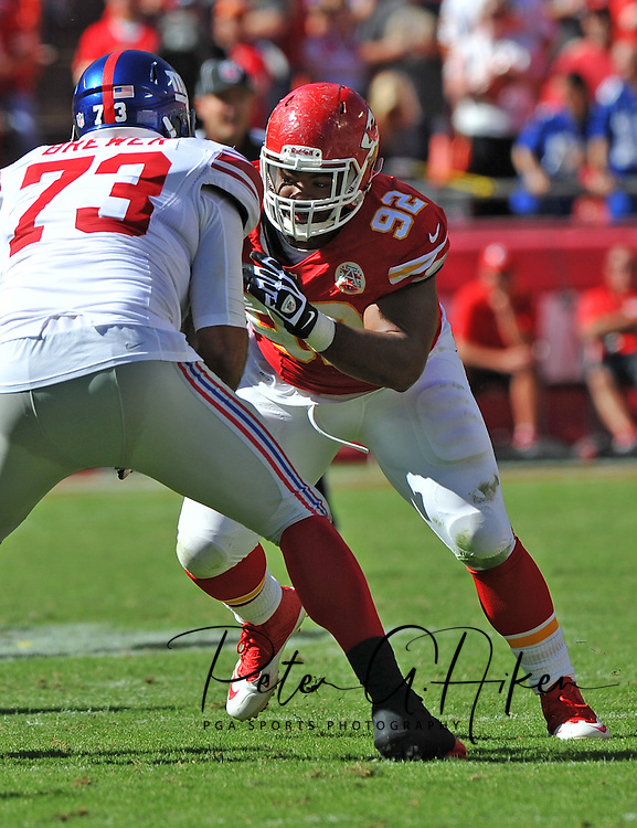 KANSAS CITY, MO - SEPTEMBER 29:  Nose tackle Dontari Poe #92 of the Kansas City Chiefs rushes against offensive tackle James Brewer #73 of the New York Giants during the second half on September 29, 2013 at Arrowhead Stadium in Kansas City, Missouri.  (Photo by Peter G. Aiken/Getty Images) *** Local Caption *** Dontari Poe;James Brewer