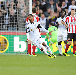 Swansea City's Jonathan de Guzman celebrates the second goal of the game. - Photo mandatory by-line: Alex James/JMP - Tel: Mobile: 07966 386802 19/10/2013 - SPORT - FOOTBALL - Liberty Stadium - Swansea - Swansea City v Sunderland - Barclays Premier League