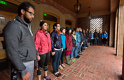Student and staff silently protest in the alcove of Karen Hille Phillips Center over the Grand Jury decision in Ferguson Missouri at PLU on Tuesday, Nov. 25, 2014. (PLU Photo/John Froschauer)