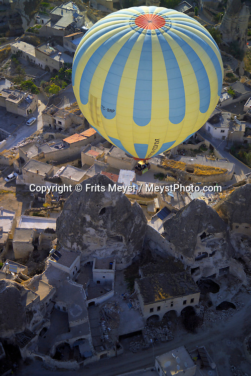 Goreme, Cappadocia, Nevsehir, Turkey. The Village of Goreme. A hot air balloon flight is one of the best ways to explore the fairy chimney landscape of Cappadocia and the Gorme National Park. Photo by Frits Meyst/Adventure4ever.com
