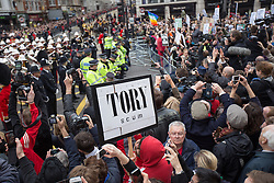 © Licensed to London News Pictures . 17/04/2013 . London , UK . A row of police separate protesters from the procession at Ludgate Circus . The funeral of former British Conservative Prime Minister , Baroness Margaret Thatcher , today (Wednesday 17th April 2013) in Central London . Baroness Thatcher died from a stroke at the age of 87 . Photo credit : Joel Goodman/LNP