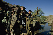 Afghanistan. Helmand province. This Soviet  soldier came over  to  the  resistance  in   1982.   He has been fighting together with the mujahidin  ever  since.   His  companions play-act his  capture.  Kandahar area  Afghanistan     /  Ce  soldat  russe  a  rejoint  la  résistance  afghane en  1982   ;  depuis,   il combat  aux côtés  des moudjahidines.   Pour  s'amuser,   ses compagnons miment son   arrestation.  Kandahar region  Afghanistan