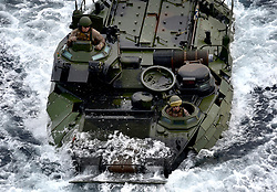 March 24, 2019 - Philippine Sea - A Marine Corps assault amphibious vehicle (AAV) enters the well deck of the amphibious assault ship USS Wasp (LHD 1). Wasp, flagship of Wasp Amphibious Ready Group, is operating in the Indo-Pacific region to enhance interoperability with partners and serve as a ready-response force for any type of contingency. (Credit Image: ? U.S. Navy /ZUMA Wire/ZUMAPRESS.com)