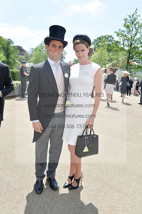 FRANCESCA CUMANI and her husband ROB ARCHIBALD at the first day of the 2014 Royal Ascot Racing Festival, Ascot Racecourse, Ascot, Berkshire on 17th June 2014.