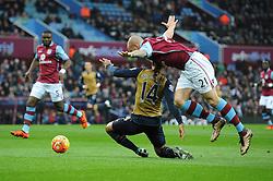 Alan Hutton of Aston Villa fouls Theo Walcott of Arsenal for a penalty - Mandatory byline: Dougie Allward/JMP - 13/12/2015 - Football - Villa Park - Birmingham, England - Aston Villa v Arsenal - Barclays Premier League