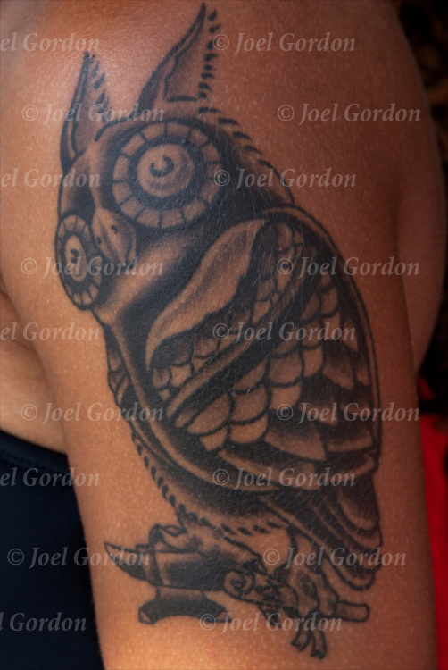 Close up of Owl tattoo on her shoulder.<br />