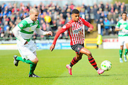 Exeter City's Ollie Watkins taking on Yeovil Town's Jakub Sokolik during the Sky Bet League 2 match between Yeovil Town and Exeter City at Huish Park, Yeovil, England on 9 April 2016. Photo by Graham Hunt.
