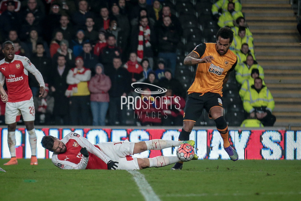 Olivier Giroud (Arsenal) knocked to the ground and a free kick is awarded during the The FA Cup fifth round match between Hull City and Arsenal at the KC Stadium, Kingston upon Hull, England on 8 March 2016. Photo by Mark P Doherty.