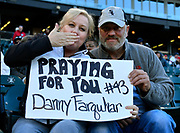 """CHICAGO, IL - APRIL 24: Fans are seen holding a sign that reads """"Praying for you #43 Danny Farquhar"""" during the game against the Seattle Mariners on April 24, 2018 at Guaranteed Rate Field in Chicago, Illinois. (Photo by Quinn Harris/Icon Sportswire)"""