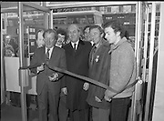 "Opening of New Ogra Fianna Fail office on O'Connell St,Dublin.1982.30.01.1982.01.30.1982.30th January 1982..Photo of Mr Charles Haughey,.Leader of Fianna Fail cutting the ribbon to officially open th new ""Ogra"" office. He is accompanied by Mr George Colley T.D.,Mr Bertie Ahearn T.D.,Mr Tom Leonard (candidate) and Mr Paul Edgehill a member of Ogra Fianna Fail."
