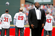ATLANTA, GA - OCTOBER 2:  Former Atlanta Braves pitchers (from left to right) Greg Maddux, John Smoltz and Tom Glavine pause while tenor Timothy Miller sings the national anthem during pre-game ceremonies to honor the last game at Turner Field during the game between the Detroit Tigers and the Atlanta Braves on Sunday, October 2, 2016 in Atlanta, Georgia. (Photo by Mike Zarrilli/MLB Photos via Getty Images) *** Local Caption ***