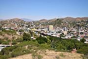 A metal wall indicates the international boundary between Nogales, Arizona, USA, and Nogales, Sonora, Mexico, as seen from Arizona.