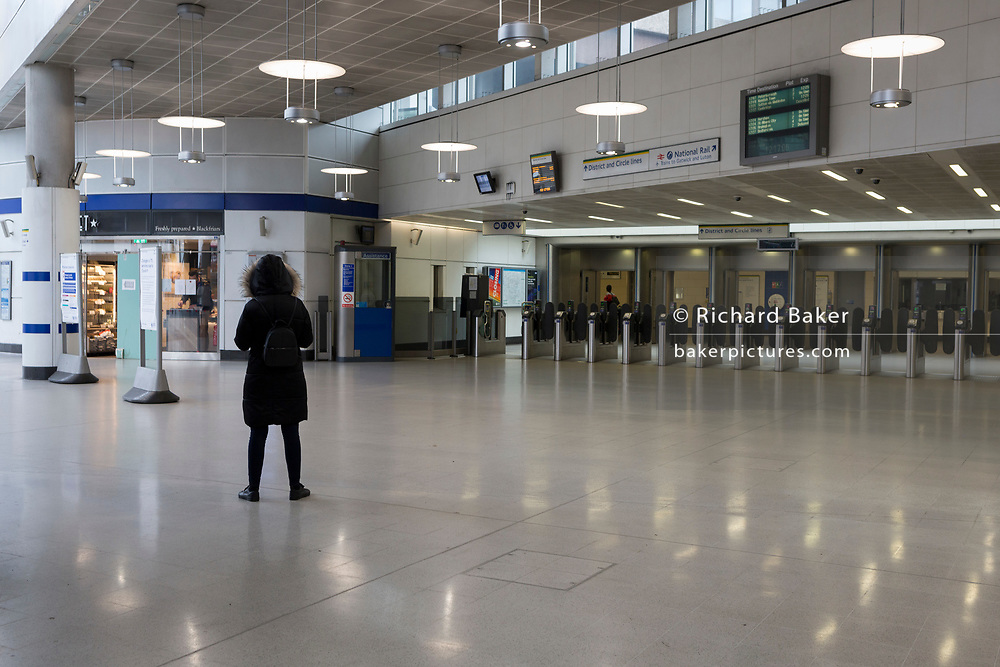 As the Coronavirus pandemic spreads across the UK, businesses and entertainment venues not already closed with the threat of job losses, struggle to stay open with growing rumours of a lockdown and travel restrictions around the capital. Londoners start to work from home leading to a quiet concourse at Blackfriars railway station, on 19th March 2020, in London, England.