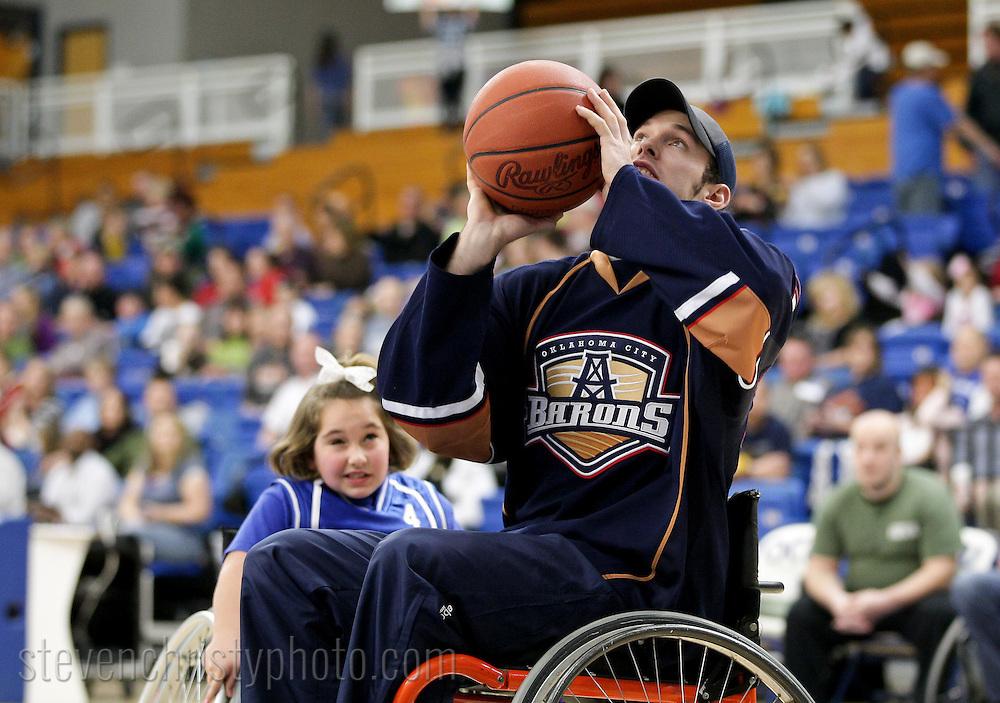 January 10, 2012: The Oklahoma City Barons of the American Hockey League play the Oklahoma Blaze in a wheelchair basketball game at Abe Lemons Arena on the campus of Oklahoma City University.