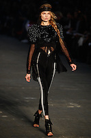 Magdalena Frackowiak walks the runway wearing Alexander Wang Spring 2010 collection during Mercedes-Benz Fashion Week in New York, NY on September 11, 2009