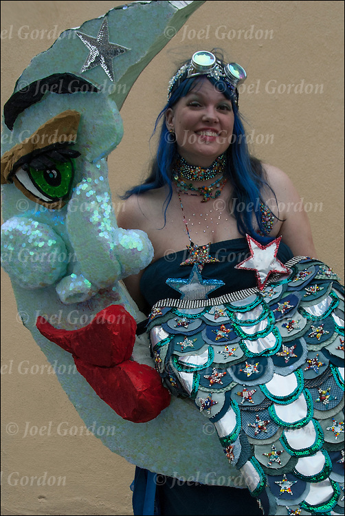 Mermaid Parade marcher dressed as Crescent Moon Mermaid costume  before the start of the parade in Coney Island.
