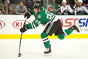 DALLAS, TX - SEPTEMBER 26:  Cody Eakin #20 of the Dallas Stars takes a shot on goal against the Colorado Avalanche on September 26, 2013 at the American Airlines Center in Dallas, Texas.  (Photo by Cooper Neill/Getty Images) *** Local Caption *** Cody Eakin