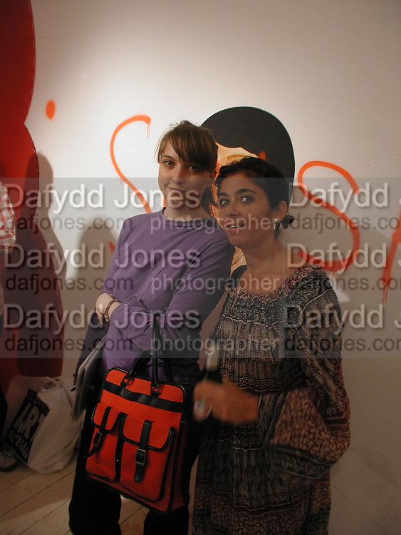 Aieta Wilson and Daisy de Villeneuve. Barry McGee private view. Modern Art. Redchurch St. 7 September 2002. © Copyright Photograph by Dafydd Jones 66 Stockwell Park Rd. London SW9 0DA Tel 020 7733 0108 www.dafjones.com