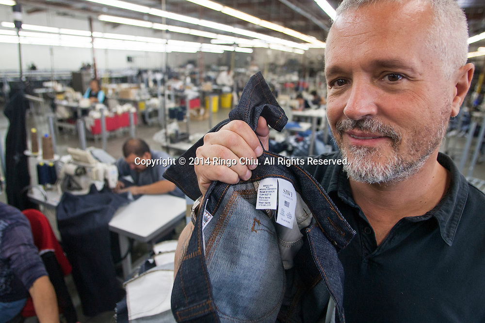 Alain Lafourcade, Chief Operating Officer, of jeans manufacturer, Siwy Denim, Inc., inside the facility.<br /> (Photo by Ringo Chiu/PHOTOFORMULA.com)