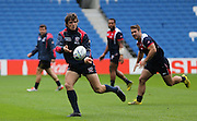 AJ MacGinty releases the ball during the USA Captain's Run in preparation for the Rugby World Cup at the American Express Community Stadium, Brighton and Hove, England on 18 September 2015.