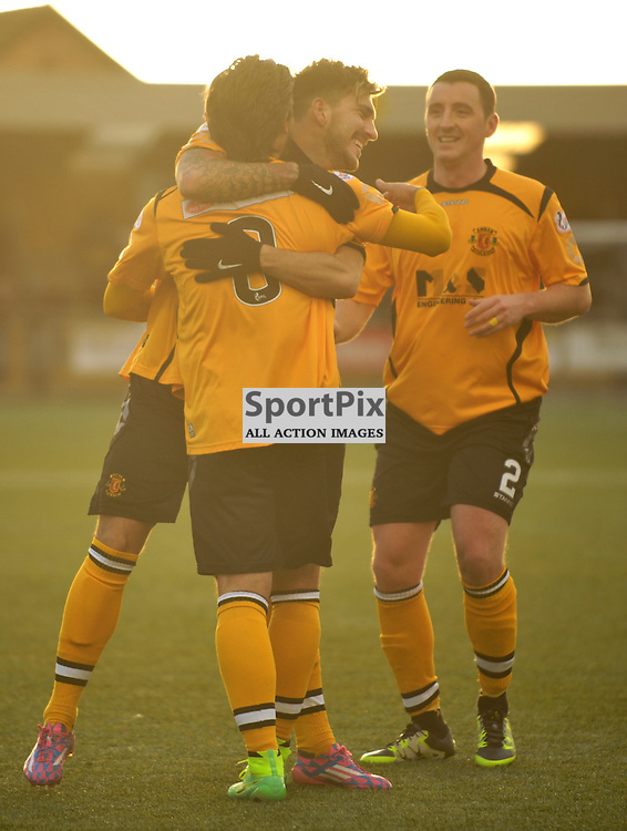 Matty Flynn  (Annan Athletic, amber &amp; black) scores the second goal as Elgin defenders claim offside<br /> <br /> Annan Athletic v Elgin City, SPFL League 2, 30th January 2016<br /> <br /> (c) Alex Todd | SportPix.org.uk