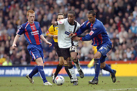 Photo: Leigh Quinnell.<br /> Derby County v Crystal Palace. Coca Cola Championship. 25/03/2006. Derbys Kevin Lisbie can't find a way past Crystal Palaces Ben Watson(L) and Fitz Hall.