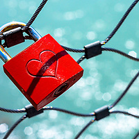 Lock lock on the Makartsteg Bridge over the Salzach River in Salzburg, Austria.