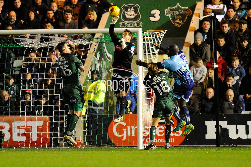 Luke McCormick (23) of Plymouth Argyle gets his hand to the ball during a Wycombe attack during the EFL Sky Bet League 2 match between Plymouth Argyle and Wycombe Wanderers at Home Park, Plymouth, England on 26 December 2016. Photo by Graham Hunt.