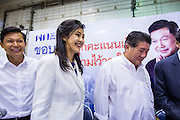 03 MARCH 2013 - BANGKOK, THAILAND: <br /> PONGSAPAT PONGCHAREON, left, the Pheu Thai candidate for Governor of Bangkok, YINGLUCK SHINAWATRA, the Thai Prime Minister, and members of the Pheu Thai leadership leave the press conference announcing that Pongsapat lost the Bangkok Governor's election. Pongsapat Pongchareon, running on the Pheu Thai ticket, lost the Bangkok's Governor's race to MR Sukhumbhand Paribatra, the incumbent running on the Democrat ticket. Sukhumbhand won the race after scoring a record number of votes, more than 1.2 million to Pongsapat's 1 million. The results were seen as an upset even though Sukhumbhand was the incumbent because all of the pre-election polls and the exit polls conducted on election day showed Patsapong winning.     PHOTO BY JACK KURTZ