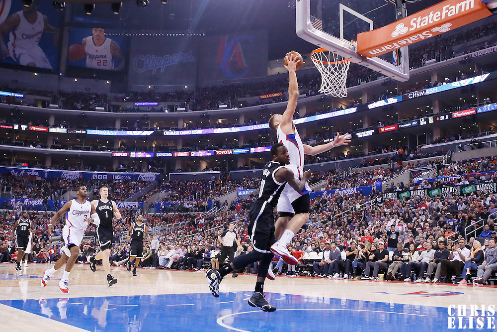 16 November 2013: Los Angeles Clippers power forward Blake Griffin (32) is fouled by Brooklyn Nets point guard Tyshawn Taylor (10) during the Los Angeles Clippers 110-103 victory over the Brooklyn Nets at the Staples Center, Los Angeles, California, USA.
