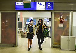 Passengers wearing face mask to prevent the spread of the new coronavirus, arrive from Amsterdam to the Eleftherios Venizelos International Airport in Athens, Monday, June 15, 2020. Greece is officially open to tourists as of Monday, with the first international flights expected into Athens and the northern city of Thessaloniki where passengers will not face compulsory COVID-19 tests. Seasonal hotels and museums are also opening across the country. <br /> <br /> Pictured: <br /> Dimitris Lampropoulos  | EEm date