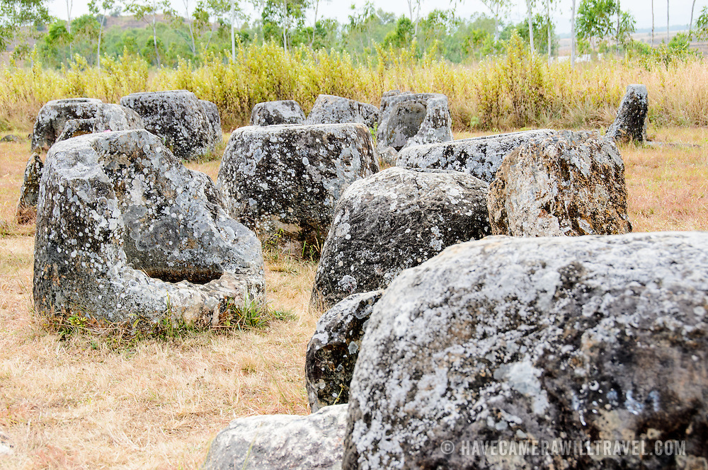 Stone jars at Site 1 of the Plain of Jars in north-central Laos. Much remains unknown about the age and purpose of the thousands of stone jars clustered in the region. Most accounts date them to at least a couple of thousand years ago and theories have been put forward that they were used in burial rituals.