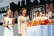 NEW YORK - JULY 25:   Fellow cast member January Jones looks on, left, as Elisabeth Moss, right, is presented with a surprise birthday cake before the live screening of AMC's Mad Men season 4 in New York's Times Square, presented by Chase Sapphire, Sunday, July 25, 2010. (Photo/Stuart Ramson / PictureGroup)