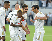 Los Angeles FC forward Latif Blessing (7) celebrates with teammates after Carlos Vela (10) scores against New York City in a MLS soccer match in Los Angeles, Sunday, May 13, 2018. The game ended in a 2-2 tie. (Ed Ruvalcaba/Image of Sport)