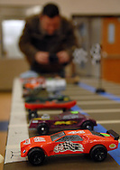 26 FEB. 2011 -- ST. LOUIS -- Tim Hopmeier photographs cars on the starting grid before the first race of the Adult Pinewood Derby sponsored by the Men's Club at Our Lady of Sorrows Catholic Church in St. Louis Saturday, Feb. 26, 2011. Proceeds from the event went to support Boy Scouts of America. Image copyright © 2011 Sid Hastings.