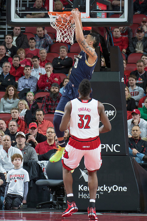 Notre Dame forward Zach Auguste dunks in the first half. <br /> <br /> The University of Louisville hosted the Notre Dame, Wednesday, March 04, 2015 at Yum Center in Louisville. <br /> <br /> Photo by Jonathan Palmer