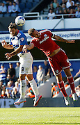 Charlie Austin heads the ball goal wards despite Sean Morrison's contest during the Sky Bet Championship match between Queens Park Rangers and Cardiff City at the Loftus Road Stadium, London, England on 15 August 2015. Photo by Andy Walter.
