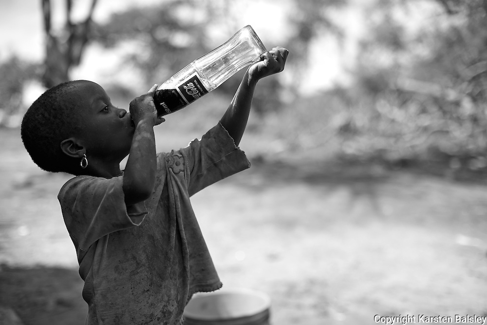 &ldquo;Coca Cola&rdquo;                                                       Tanzania<br />  She put it to her lips and drank the entire Coke in one shot!