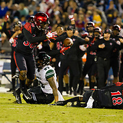 24 November 2018: San Diego State Aztecs safety Dwayne Johnson Jr. (36) recovers the ball on a punt return after safety Trenton Thompson (18) knocked the ball free from Hawaii Warriors punt returner Justice Augafa (82) in the first quarter.  The Aztecs closed out the season with a 31-30 overtime loss to Hawaii at SDCCU Stadium.