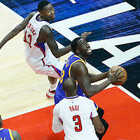 07 December 2016: Golden State Warriors forward Draymond Green (23) eyes the basket between LA Clippers guard Jamal Crawford (11) and LA Clippers guard Chris Paul (3) during the Golden State Warriors 115-98 victory over the Los Angeles Clippers, at the Staples Center, Los Angeles, California, USA.