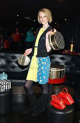 Model JADE PARFITT at a preview of Lulu Guinness's new Handbag Collection ' Couture' held at Aviva, Baglioni Hotel, 60 Hyde Park Gate, London SW7 on 15th February 2006.<br />