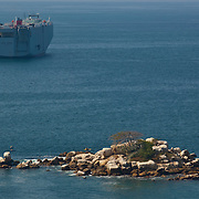 Cargo ship waiting on bay of Acapulco. Guerrero, Mexico
